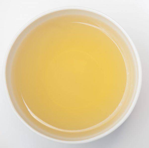 Premium Green & White Pomegranate & Dragonfruit Tea in a cup